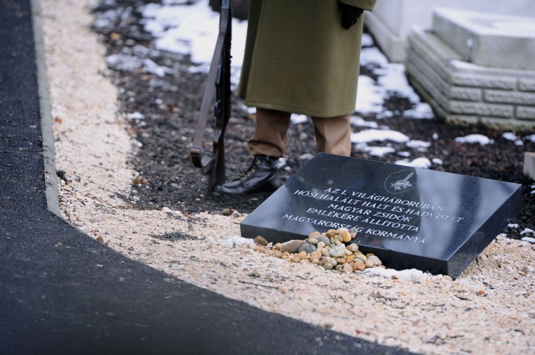 A Hungarian soldier stands by the memorial for the Jewish-born Hungarian soldiers fallen in WWI inaugurated at the Kozma street Jewish cemetery in Budapest, on January 26, 2015. (ATTILA KISBENEDEK/AFP/Getty Images)