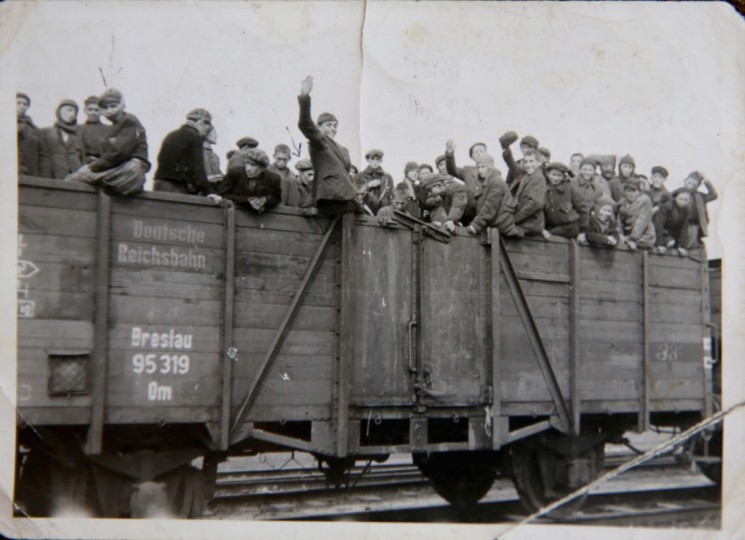 A photograph from the collection of Auschwitz concentration camp survivor Alexander Riseman (3rd left) taken on a train, two days before the end of WWII is reproduced on December 1, 2014 in London, United Kingdom. Alexander and his family were sent to Aushwitz from his home in Poland as a child and eventually liberated by the Russian forces. (Photo by Christopher Furlong/Getty Images)