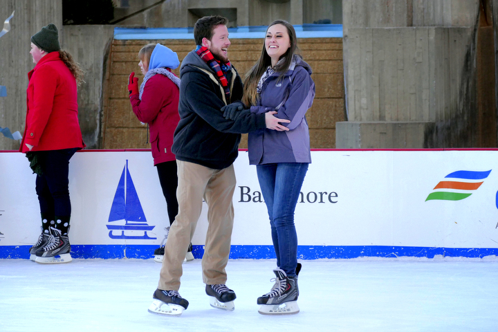 Brandon Salyers of Federal Hill leads Tracy Lieb of Canton as they skate on the ice at McKeldin Square. (Karl Merton Ferron/Baltimore Sun)
