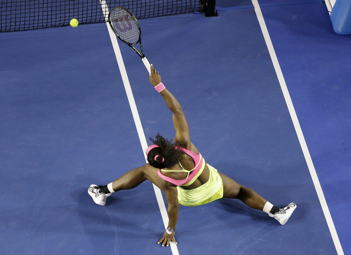 Serena Williams of the U.S. slips while playing shot back to Maria Sharapova of Russia during the women's singles final at the Australian Open tennis championship in Melbourne, Australia, Saturday. (Lee Jin-man/AP Photo)