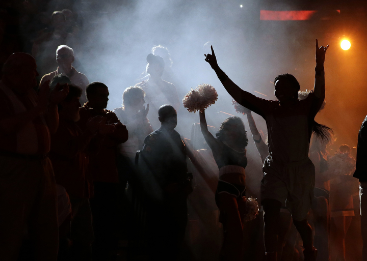 Texas basketball player Nneka Enemkpali runs onto the court during introductions prior to an NCAA college basketball game against Texas Tech in Austin, Texas. (Eric Gay/AP Photo)