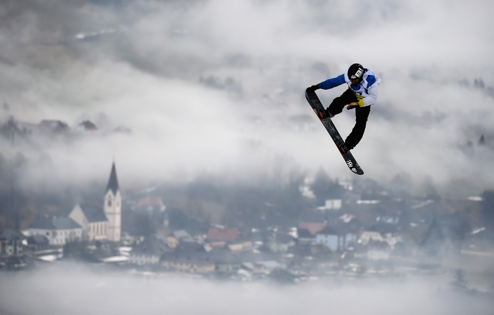 A snowboarder makes his run in the Snowboard Slopestyle competition of the FIS Freestyle Ski World Championships in Kreischberg, Austria (Lars Baron/Getty Images)