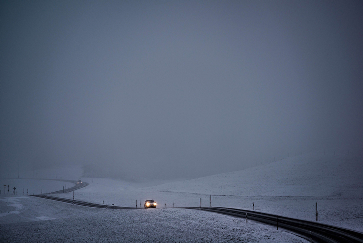 A car makes its way through the snow-covered landscape near Hopferau, southern Germany. (Nicolas Armer/AFP-Getty Images)
