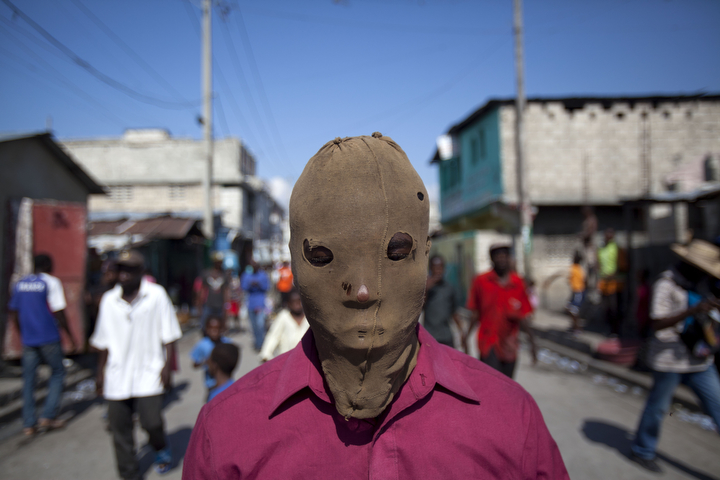 A masked demonstrator takes part in a protest to demand the resignation of President Michel Martelly, in Port-au-Prince, Haiti. The protest was the latest in a series of demonstrations demanding Martelly leave office before his term expires next year. (Dieu Nalio Chery/AP Photo)