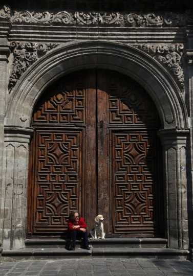 Cachi and her master wait for the start of a feast day Mass in honor of Saint Anthony, the patron saint of animals, at the Saint Fernando church, in Mexico City. Many people in Mexico bring their pets to churches to be blessed by the priest on this day. (Marco Ugarte/AP Photo)