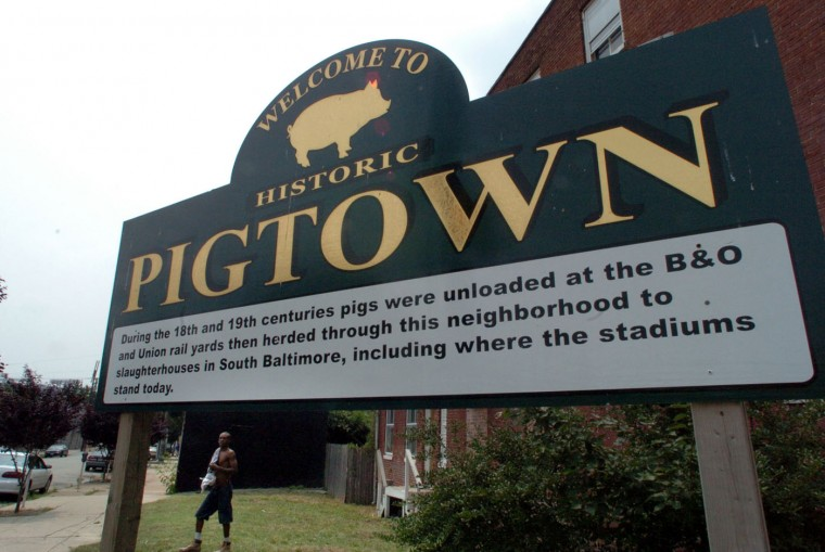 7/21/06: In Pigtown/Washington Village, large signs greets people coming into the neighborhood of Pigtown and explains the history behind the name. Monica Lopossay/Baltimore Sun