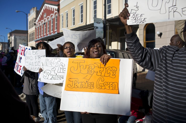 Protesters along the street to chant for justice before they march to the Edmund Pettus Bridge in honor of Martin Luther King Jr.,Sunday, Jan. 18, 2015, in Selma, Ala. (AP Photo/Brynn Anderson)