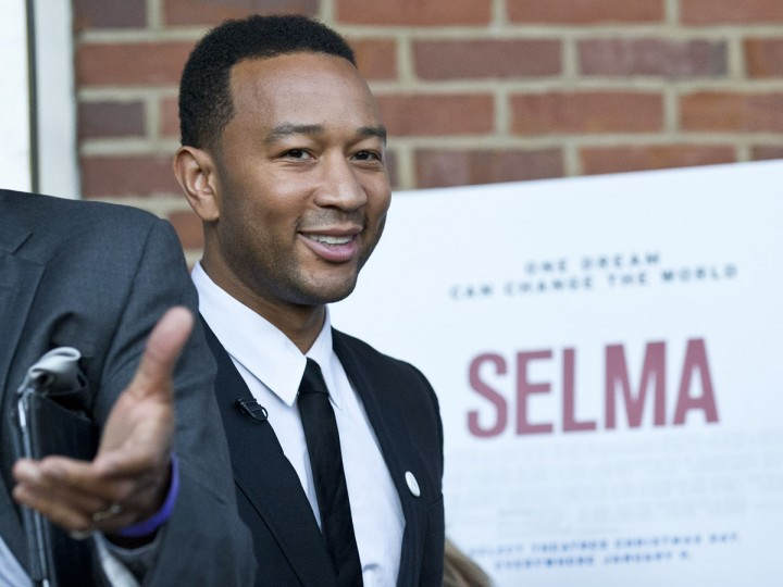 Singer and song writer John Legend makes his way to the Edmund Pettus Bridge in honor of Martin Luther King Jr.,Sunday, Jan. 18, 2015, in Selma, Ala. (AP Photo/Brynn Anderson)