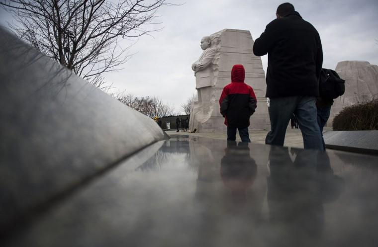 People walk at the Martin Luther King Jr. Memorial on the National Mall on MLK Day January 19, 2015 in Washington, D.C. Martin Luther King day was marked by many celebrations across the country. (Photo by Gabriella Demczuk/Getty Images)