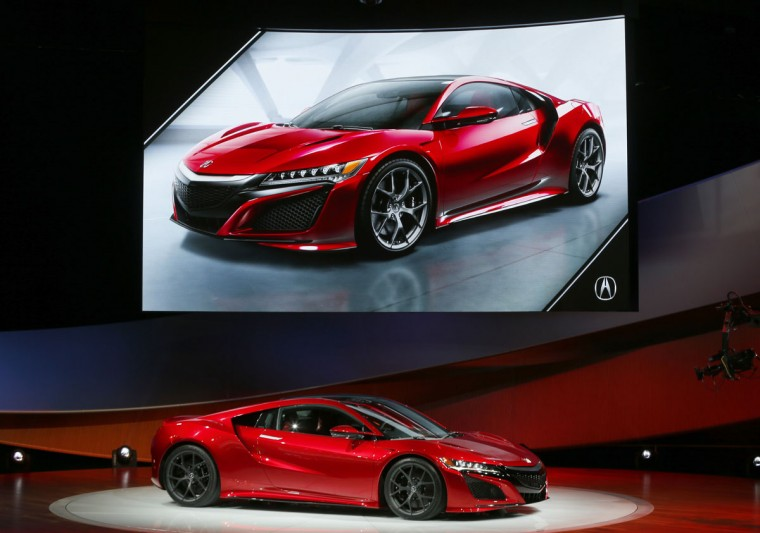 The 2016 Acura NSX debuts at media previews for the North American International Auto Show in Detroit Monday, Jan. 12, 2015. (AP Photo/Paul Sancya)