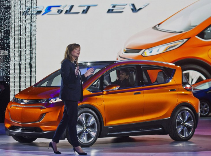 General Motors CEO Mary Barra presents the Bolt EV electric concept vehicle at the North American International Auto Show, Monday, Jan. 12, 2015, in Detroit. (AP Photo/Tony Ding)