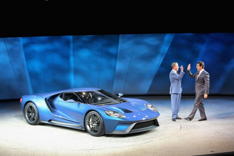 Bill Ford (left), Executive Chairman of Ford Motor Company, and Mark Fields, President and Chief Executive Officer of Ford Motor Company, celebrate the launch of the Ford GT at the North American International Auto Show (NAIAS) on January 12, 2015 in Detroit. (Photo by Scott Olson/Getty Images)
