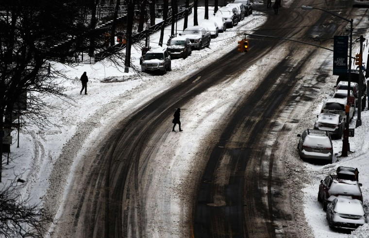 A woman crosses a nearly deserted street in New York after a snowstorm on January 27, 2015. (JEWEL SAMAD/AFP/Getty Images)