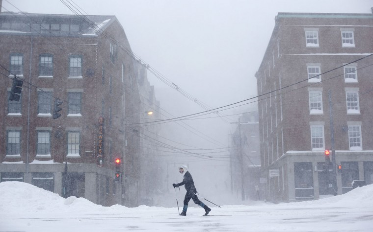 "Lisetta Shah cross-country skis on Commercial Street in Portland, Maine, Tuesday, Jan 27, 2015, during a winter storm in downtown Portland, Maine. ""I'll probably never get another chance to ski in the city,"" she said, explaining why she was outing the blizzard. (AP Photo/Robert F. Bukaty)"
