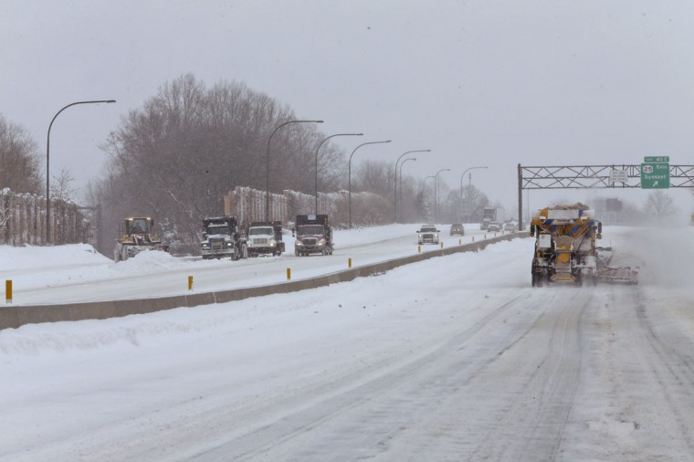 Snow plows and salt trucks clear snow from the Long Island Expressway, Tuesday, Jan. 27, 2015 in Mineola, N.Y. (AP Photo/Mary Altaffer)