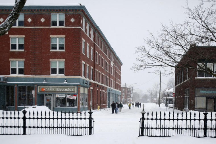 People walk on Bradford Street during a driving ban, Tuesday, Jan. 27, 2015, in Pittsfield, Mass., after a winter storm roared up the East Coast. (AP Photo/The Berkshire Eagle, Stephanie Zollshan)