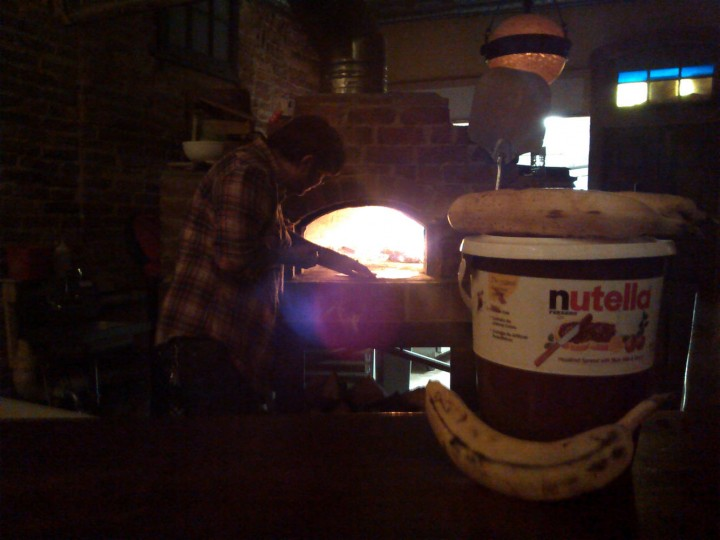 Last shot pre-midnight, Jesse from Arthouse making the perfect winter treat, Nutella and banana pizza.
