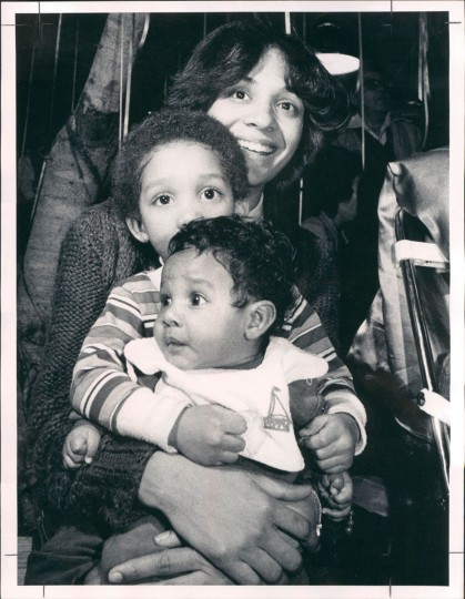 Tegra Featherstone with three-year-old Justin and 12-week-old Matthew at a Mardi Gras celebration at Harbor Place on February 15, 1983. (William Hotz/Baltimore Sun)