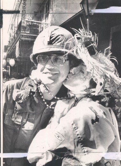 National Guardsman is given some beads and a kiss from a Mardi Gras reveler during the celebration on Bourbon Street on February 27, 1979. The National Guard patrolled the French Quarter since the police remained on strike. (Pat Benic/UPI)
