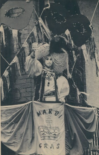 A carnival masker toasts the crowd from a New Orleans French Quarter balcony Tuesday, February 19, 1985. With an estimated million people jammed into the city a balcony is a great place to view the Mardi Gras festivities. (Bill Haber/AP Laserphoto)