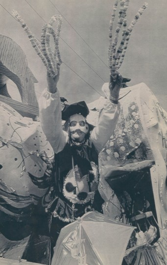 A masked rider in the Carrollton parade tosses beads from his float on Sunday, January 29, 1989 in New Orleans. (Burt Steel/AP Laserphoto)