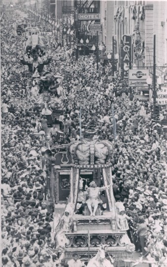 At least a million spectators lined the streets of New Orleans on March 2, 1965 to hail Rex, King of Carnival, as he passed during Mardi Gras celebrations. Rex is riding the float in the foreground. (AP Wirephoto)
