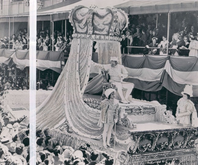 Rex, the King of Carnival, waves to cheering thousands celebrating Mardi Gras as he leads a 22-float parade through New Orleans on March 6, 1962. Red is Eben Hardie, New Orleans business executive and civic leader. (AP Wirephoto)