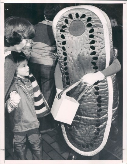 Mrs. Connie Coleman and six-year-old Jennifer meeting the watermelon at a Mardi Gras celebration on February 15, 1983 at Harbor Place. (William Hotz/Baltimore Sun)