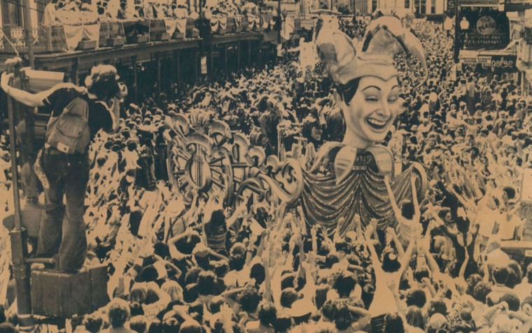 The procession of Rex, king of carnival, turns onto Canal Street in New Orleans amid hundred of thousand who filled the streets. One picture taker has a perfect perch on a traffic light pole to make his Mardi Gras snaps. (AP Wirephoto, 1977)