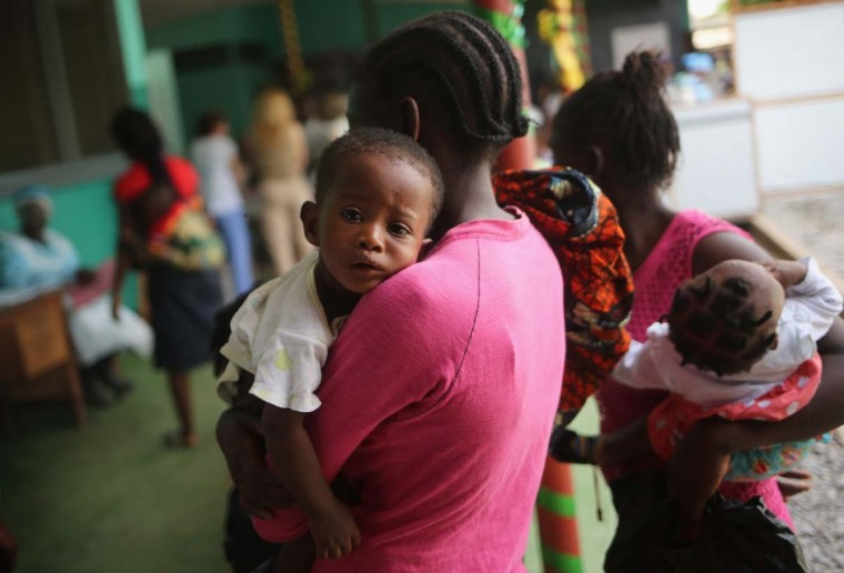 Mothers bring their sick children for treatment at Redemption Hospital, formerly an Ebola holding center, on February 2, 2015 in Monrovia, Liberia. Life is slowly returning to normal for many Liberians, and most hospitals and clinics have re-opened as the Ebola epidemic wanes. The Ebola epidemic virus has killed at least 3,700 people in Liberia alone, the most of any country, and nearly 9,000 across in West Africa. (Photo by John Moore/Getty Images)