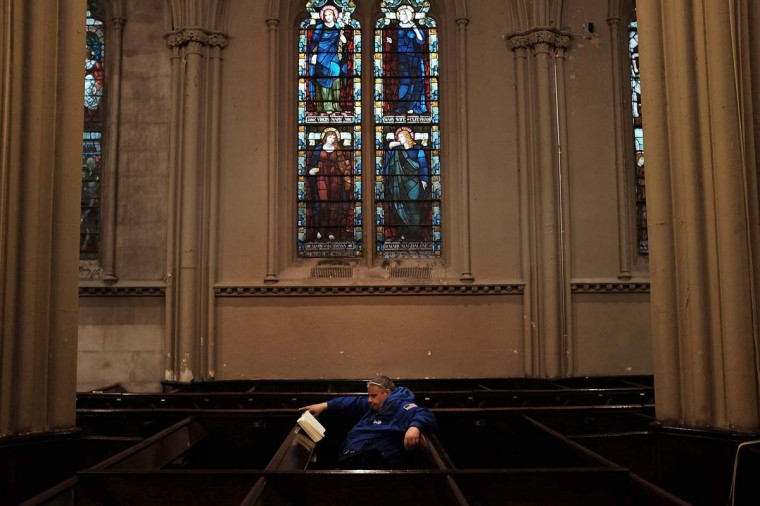 A man finds warmth and quiet in a Manhattan church on February 2, 2015 in New York City. Another winter storm has brought inclement weather to much of the Northeast, canceling schools and hundreds of flights throughout the New York metro area. (Spencer Platt/Getty Images)