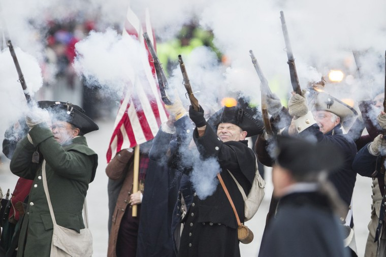 "The New England Patriots ""End Zone Militia"" fire their weapons during the New England Patriots victory parade on February 4, 2015 in Boston, Massachusetts. (Photo by Scott Eisen/Getty Images)"