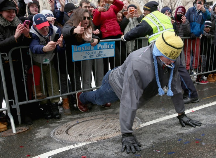 Tight end Rob Gronkowski of the New England Patriots does push ups during a Super Bowl victory parade on February 4, 2015 in Boston, Massachusetts. The Patriots defeated the Seattle Seahawks 28-24 in Super Bowl XLIX.The Patriots defeated the Seattle Seahawks 28-24 in Super Bowl XLIX. (Photo by Billie Weiss/Getty Images)