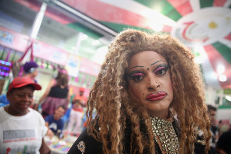 A reveler poses during the Gay Glam Ball inside the Mangueira samba school on February 11, 2015 in Rio de Janeiro, Brazil. Carnival runs this year February 13-17. (Photo by Mario Tama/Getty Images)