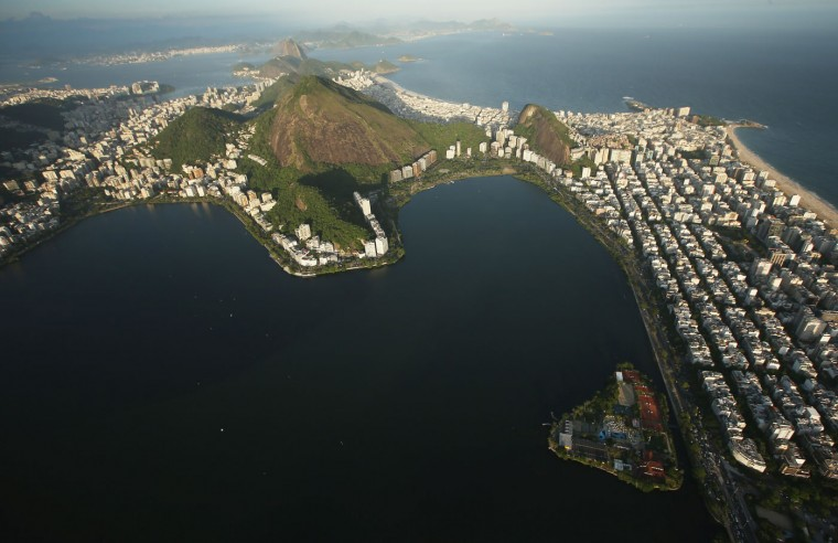 The sun begins to set over Lagoa Rodrigo de Freitas, which will host rowing and canoeing events for the Rio 2016 Olympic Games, on February 24, 2015 in Rio de Janeiro, Brazil. The city of Rio continues to prepare to host the upcoming Olympic Games which kickoff on August 5, 2016. (Photo by Mario Tama/Getty Images)