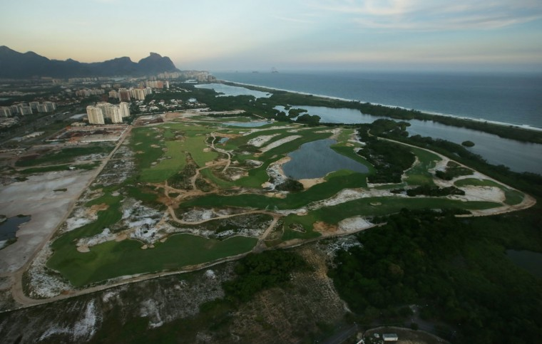 Construction continues at the golf course for the Rio 2016 Olympic Games in the Barra da Tijuca neighborhood on February 24, 2015 in Rio de Janeiro, Brazil. The city of Rio continues to prepare to host the upcoming Olympic Games which kickoff on August 5, 2016. (Photo by Mario Tama/Getty Images)