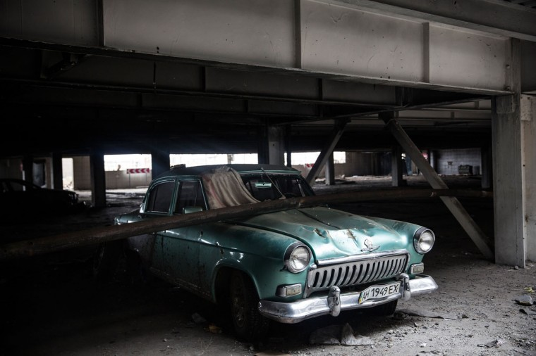 A partially damaged car sits parked in the Donetsk airport parking lot on February 26, 2015 in Donetsk, Ukraine. The Donetsk airport has been one of the most heavily fought over pieces of land between the Ukrainian army and pro-Russian rebels. (Photo by Andrew Burton/Getty Images)