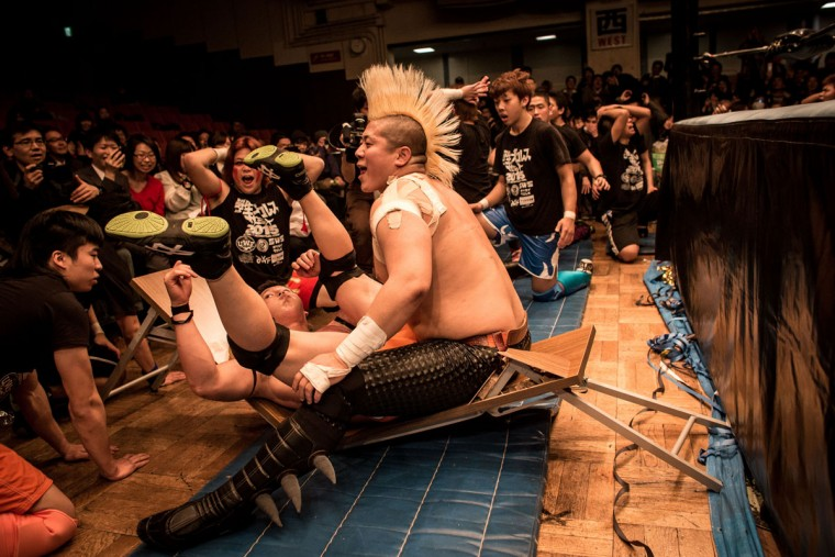 Student wrestlers break a table during the Student Pro-Wrestling Summit on February 26, 2015 in Tokyo, Japan. (Photo by Chris McGrath/Getty Images)