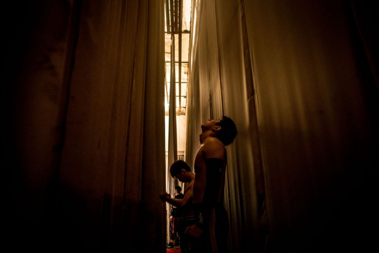 Student wrestlers wait behind the stage curtain before entering the arena for their fight during the Student Pro-Wrestling Summit on February 26, 2015 in Tokyo, Japan. (Photo by Chris McGrath/Getty Images)