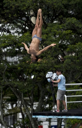 Bulgarian Todor Spasov dives from the 27-meter-high platform during the Red Bull Qualifier Cliff Diving World Series 2015 at the Pools Hernando Botero O'Byrne in Cali, department of Valle del Cauca, Colombia, on February 7, 2015. Luis Robayo/AFP/Getty Images