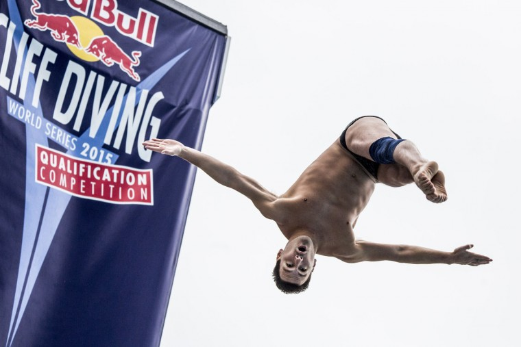 This handout photo received from Red Bull and taken on February 7, 2015 shows Blake Aldridge of the UK diving from the 27 metre platform during the final rounds of the Red Bull Cliff Diving World Series qualification competition at Piscinas Panamericanas, Cali, Colombia. Five divers, Jonathan Paredes of Mexico, Jucelino Junior of Brazil, Andy Jones of the USA, Blake Aldridge of the UK and Michal Navratil of the Czech Republic qualified and will join the five pre-qualified divers from last year in the 2015 season. Dean Treml/AFP/Red Bull/Getty Images
