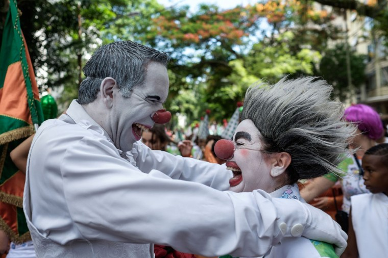 Revelers of Bloco Gigantes da Lira perform on a street during the pre-carnival parade in Rio de Janeiro, Brazil on February 8, 2015. (Yasu Yoshi Chiba/AFP/Getty Images)