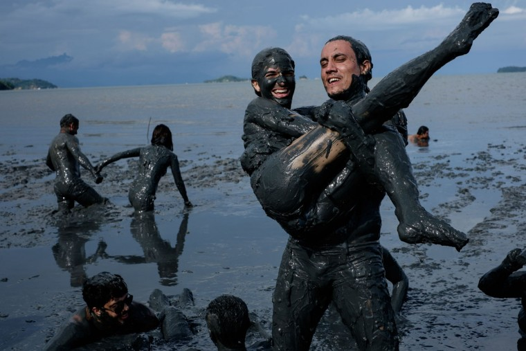 "Revellers prepare for ""Bloco da Lama,"" a mud carnival in Paraty, about 250km south of Rio de Janeiro, Brazil, on February 14, 2015. ""Bloco da Lama"" was started in 1986 by two teenagers playing with mud. Yasuyoshi Chiba/AFP/Getty Images"