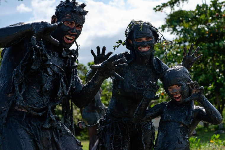 "A family of revellers poses as they play ahead of ""Bloco da Lama,"" a mud carnival in Paraty, about 250km south of Rio de Janeiro, Brazil, on February 14, 2015. ""Bloco da Lama"" was started in 1986 by two teenagers playing with mud. Yasuyoshi Chiba/AFP/Getty Images"