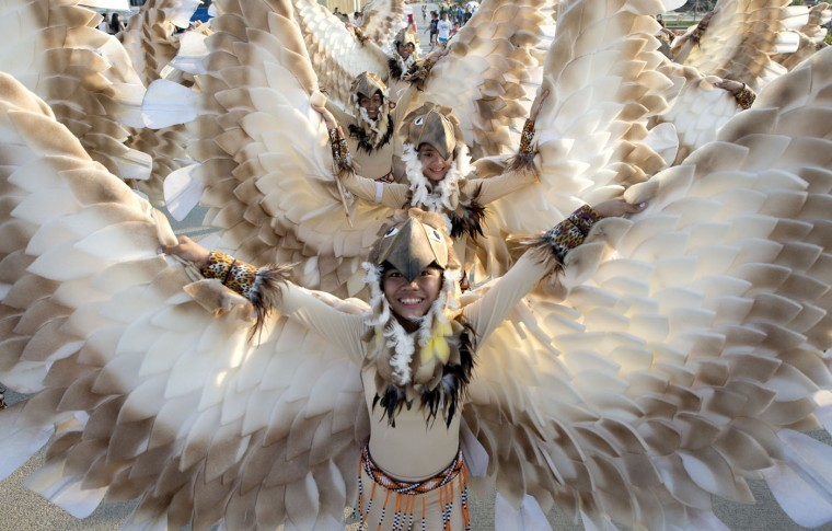 Students wearing bird costumes dance during the annual Caracol Festival in Manila on February 22, 2015. Participants of the Caracol Festival dress in different costumes of wildlife and endangered species to express the need to preserve Manila's environment and cultural heritage. (Noel Celis/AFP/Getty Images)