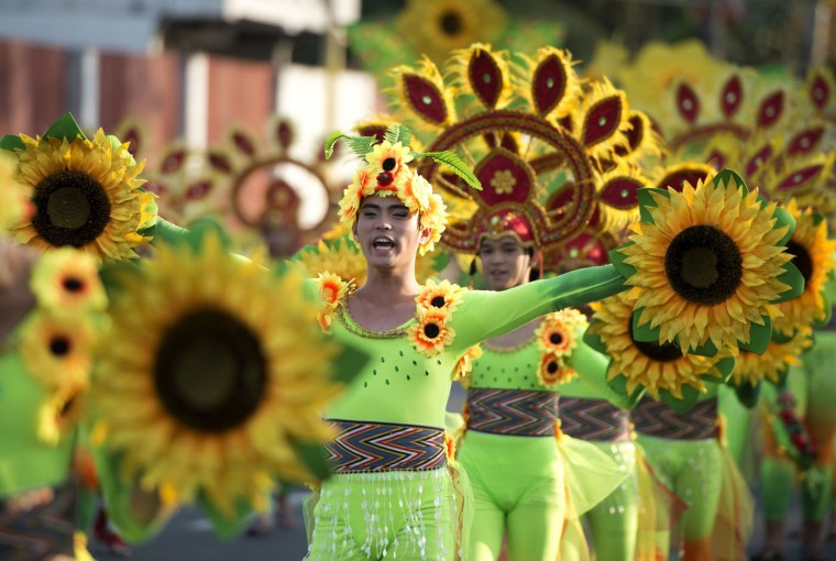 Students wearing flower costumes dance during the annual Caracol Festival in Manila on February 22, 2015. Participants of the Caracol Festival dress in different costumes of wildlife and endangered species to express the need to preserve Manila's environment and cultural heritage. (Noel Celis/AFP/Getty Images)