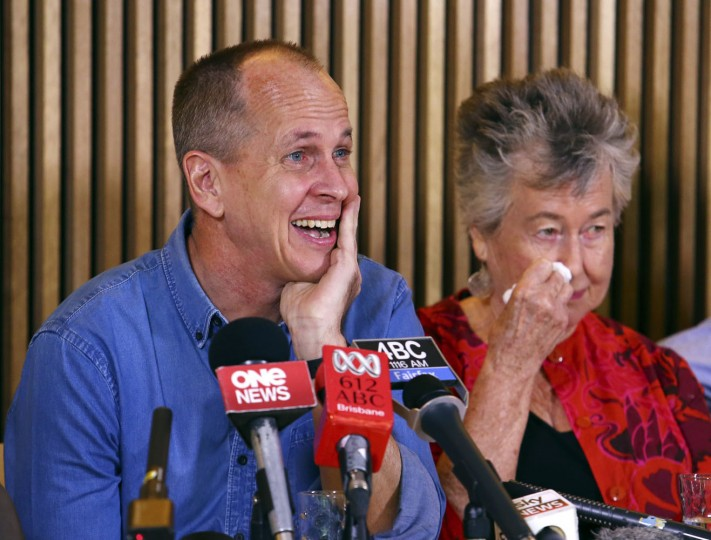 Australian journalist Peter Greste, left, and his mother Lois attend a press conference in Brisbane, Australia, Thursday, Feb. 5, 2015. The Al-Jazeera reporter who spent more than a year in an Egyptian prison returned home to Australia on Thursday, where he was greeted by friends and relieved family members who had tirelessly campaigned for his release. (AP Photo/Tertius Pickard)