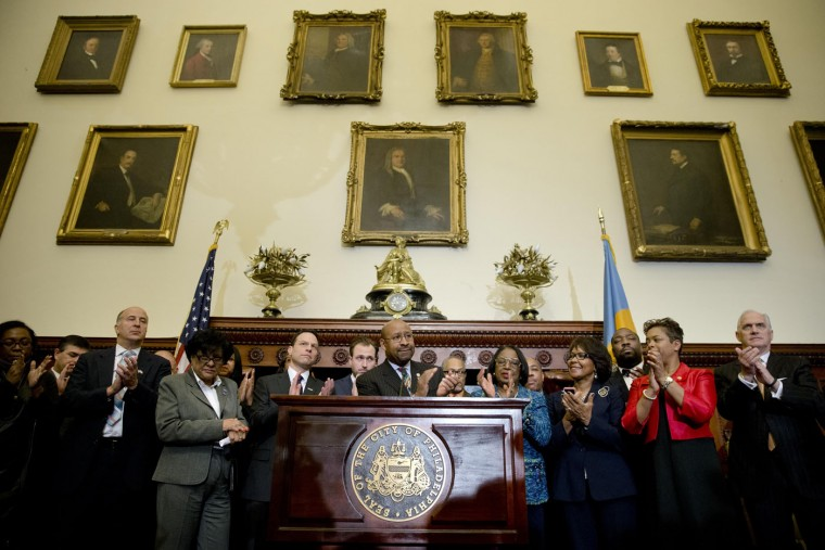 Philadelphia Mayor Michael Nutter, center, and others applaud during a news conference, Thursday, Feb. 12, 2015, at City Hall in Philadelphia. Democrats have selected Philadelphia as the site of the party's 2016 national convention, choosing a patriotic backdrop for the nomination of its next presidential candidate. The convention will be held the week of July 25, 2016 (Matt Rourke/AP)