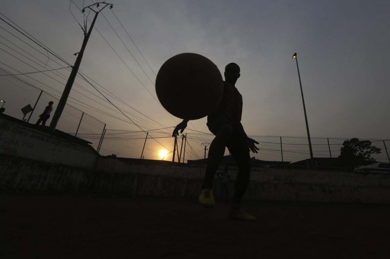 A child plays soccer at Mene Ela neighborhood, in Malabo, Equatorial Guinea, Monday Feb. 2, 2015. Malabo is holding the African Cup of Nations Semifinal match on Thursday between Ghana and Equatorial Guinea, at Estadio De Malabo. (AP Photo/Sunday Alamba)