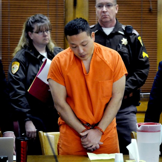 Markus Kaarma stands in Missoula County District Court while Judge Ed McLean sentences him to 70 years in prison for the shooting death of German exchange student Diren Dede on Thursday, Feb. 12, 2015 in Missoula, Mont. Kaarma shot 17-year-old Dede, who was unarmed, last year after he was alerted by motion sensors in his garage. Witnesses said Kaarma fired at the teen four times. (Kurt Wilson/The Missoulian/AP)